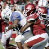 Tulsa running back Trey Watts (22) is stopped by Arkansas defensive end Colton Miles-Nash (90) during the first half of an NCAA college football game in Fayetteville, Ark., Saturday, Nov. 3, 2012. (AP Photo/Danny Johnston)