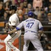 Los Angeles Dodgers pitcher Ricky Nolasco (47) tags out San Francisco Giants\' Tony Abreu between third base and home plate during the second inning of a baseball game in San Francisco, Wednesday, Sept. 25, 2013. (AP Photo/Jeff Chiu)
