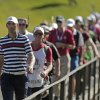 USA\'s Dustin Johnson walks across the bridge on the 13th hole during a singles match at the Ryder Cup PGA golf tournament Sunday, Sept. 30, 2012, at the Medinah Country Club in Medinah, Ill. (AP Photo/Charlie Riedel) ORG XMIT: PGA155
