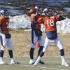 Photo - Denver Broncos quarterback Peyton Manning (18) throws a pass at practice for the football team's NFL playoff game against the San Diego Chargers at the Broncos training facility in Englewood, Colo., on Wednesday, Jan. 8, 2014. Backup quarterbacks Zac Dysert (2) and Brock Osweiler (17) watch. (AP Photo/Ed Andrieski)