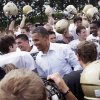 Photo - FILE - In this Aug. 17, 2011 file photo, President Barack Obama huddles with the Galesburg High School football team in Galesburg, Ill., during a three-day economic bus tour. The president has developed a lasting tie to this small, economically bruised town with an empty refrigerator plant and a liberal arts college where he likes to roll-out big economy speeches. He is scheduled to give an economic speech at Knox College in Galesburg on Wednesday, July 24, 2013. (AP Photo/Carolyn Kaster, File)