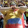 A Colombian supporter gestures before the group C World Cup soccer match between Colombia and Ivory Coast at the Estadio Nacional in Brasilia, Brazil, Thursday, June 19, 2014. (AP Photo/Marcio Jose Sanchez)