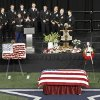Christopher Kyle\'s wife, Taya, wipes tears away while memorializing her husband during a memorial service at Cowboys Stadium, Monday, Feb. 11, 2013, in Arlington, Texas. Thousands attended the public memorial service for Kyle, the former Navy SEAL sniper who was shot to death at a Texas shooting range. (AP Photo/Brandon Wade)