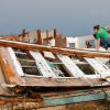 Rebecca Apel, 15, climbs on top of a toppled wall on the west side of her family\'s home in search of her pet birds. She located the cage, but only one of her four birds survived after a tornado came through the area Tuesday afternoon, May 24, 2011, Photo by Jim Beckel, The Oklahoman