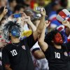 US fans cheer during the group G World Cup soccer match between Ghana and the United States at the Arena das Dunas in Natal, Brazil, Monday, June 16, 2014. (AP Photo/Julio Cortez)