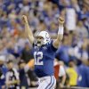 Photo - Indianapolis Colts quarterback Andrew Luck (12) celebrates after throwing a touchdown pass against the Kansas City Chiefs during the second half of an NFL wild-card playoff football game Saturday, Jan. 4, 2014, in Indianapolis. (AP Photo/Michael Conroy)