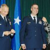 Patrick Raglow, center, receives a military honor in this photograph that includes his wife, Andrea at right. Photo provided