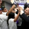 FILE - In this March 6, 2012, file photo, Gavin Maloof, right, co-owner of the Sacramento Kings, celebrates with Kings fans after the Sacramento City Council approved a plan to help finance a new arena, in Sacramento, Calif. After backing out of the deal to build a new arena in Sacramento and announcing the sale of the Kings to a group that wants to move the team to Seattle, the Maloof brothers have become the city\'s most-reviled villains heading into a preliminary NBA meeting on the issue Wednesday, April 3, 2013, in New York. (AP Photo/Rich Pedroncelli, File)