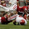 Javon Harris (30) flies over the tackle of Brennan Clay (24) by Tony Jefferson (bottom) during the University of Oklahoma (OU) football team\'s annual Red and White Game at Gaylord Family/Oklahoma Memorial Stadium on Saturday, April 14, 2012, in Norman, Okla. Photo by Steve Sisney, The Oklahoman