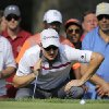 Justin Rose, of England, inspects his putt on the 15th green during the final round of the Quicken Loans National PGA golf tournament, Sunday, June 29, 2014, in Bethesda, Md. (AP Photo/Patrick Semansky)