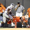 OSU\'s Brandon Pettigrew scores in the fourth quarter as KSU\'s Justin McKinney defends during the Oklahoma State University (OSU) college football game with Kansas State University (KSU) at Boone Pickens Stadium in Stillwater, Okla. Saturday Oct. 20, 2007. BY STEVE GOOCH, THE OKLAHOMAN