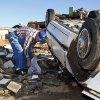 Jerome Whittington attempts to salvage belongings through the window of his automobile in Tushka, Okla., Friday, April 15, 2011, following a tornado Thursday night. (AP Photo/Sue Ogrocki)
