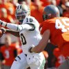 Baylor\'s Robert Griffin III (10) passes the ball as Caleb Lavey (45) of OSU defends during a college football game between the Oklahoma State University Cowboys (OSU) and the Baylor University Bears (BU) at Boone Pickens Stadium in Stillwater, Okla., Saturday, Oct. 29, 2011. Photo by Nate Billings, The Oklahoman