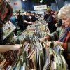 Book sale visitors search through children\'s books. Several thousand bibliophiles and bargain hunters crowded into Oklahoma Expo Hall at State Fair Park on Saturday, Feb. 23, 2013, in a quest to find reading material at deeply discounted prices. Friends of the Metropolitan Library System is holding their much-anticipated annual book sale this weekend. The sale continues Sunday from 9 a.m. to 5:30 p.m. Photo by Jim Beckel, The Oklahoman