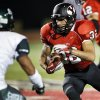 Yukon\'s A.J. West (32) carries the ball during a high school football game between Yukon and Edmond Santa Fe in Yukon, Okla., Friday, Sept. 7, 2012. Photo by Nate Billings, The Oklahoman