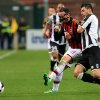 Photo - AC Milan's Giampaolo Pazzini, left, and Udinese's Igor Bubnjic fight for the ball during the Serie A soccer match between Udinese and AC Milan at the Friuli Stadium in Udine, Italy, Saturday, March 8, 2014. (AP Photo/Paolo Giovannini)
