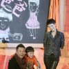 Photo - In this Wednesday Dec. 5, 2012 photo, Chinese actor Wen Zhang, left, and his wife Ma Yili, a producer and actress pose with a child actor as they attend a presser for their TV series