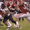 Texas Tech\'s Aaron Crawford (32) runs past Oklahoma\'s Jamarkus McFarland (97) and Frank Alexander (84) during the college football game between the University of Oklahoma Sooners (OU) and Texas Tech University Red Raiders (TTU) at the Gaylord Family-Oklahoma Memorial Stadium on Sunday, Oct. 23, 2011. in Norman, Okla. Photo by Chris Landsberger, The Oklahoman