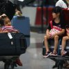 Photo -   Children sit on the luggage carts as they stranded at the Beijing Capital International Airport after flights are canceled due to the heavy rains in Beijing, China Saturday, July 21, 2012. Heavy downpour flooded roads and caused hundreds of flights to be canceled in the capital. (AP Photo) CHINA OUT