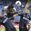 Photo - Atalanta defender Mario Yepes, top, of Colombia, jumps for the ball with Inter Milan Colombian midfielder Fredy Guarin, left, and Inter Milan forward Mauro Icardi, of Argentina, during their Serie A soccer match at the San Siro stadium in Milan, Italy, Sunday, March 23, 2014. (AP Photo/Antonio Calanni)