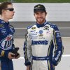 Brad Keselowski, left, and Brian Vickers talk before qualifying for the NASCAR Sprint Cup Series auto race, Saturday, March 31, 2012, at the Martinsville Speedway in Martinsville, Va. (AP Photo/Steve Sheppard) ORG XMIT: VASS207