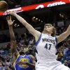 Photo - Minnesota Timberwolves' Andrei Kirilenko of Russia, right, loses the ball on a layup attempt as he is fouled by Golden State Warriors' Harrison Barnes in the first quarter of an NBA basketball game Sunday, Feb. 24, 2013, in Minneapolis. (AP Photo/Jim Mone)