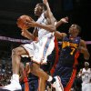 Oklahoma City\'s Kevin Durant moves to the hoop past Kelenna Azubuike of Golden State in the first half during the NBA basketball game between the Golden State Warriors and the Oklahoma City Thunder at the Ford Center in Oklahoma City, Monday, December 8, 2008. BY NATE BILLINGS, THE OKLAHOMAN