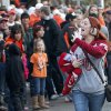 OU fan Brooke Smith waves to the OSU fans that boo her as she walks through the crowd before the \'Sprit Walk