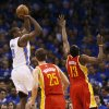 Oklahoma City\'s Serge Ibaka (9) shoots against Houston\'s Chandler Parsons (25) and James Harden (13) in the first half during Game 5 in the first round of the NBA playoffs between the Oklahoma City Thunder and the Houston Rockets at Chesapeake Energy Arena in Oklahoma City, Wednesday, May 1, 2013. Photo by Nate Billings, The Oklahoman