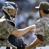 San Diego Padres catcher Nick Hundley congratulates closer Huston Street after Street saved the Padres\' 6-4 win over the San Francisco Giants in a baseball game in San Diego, Sunday, April 28, 2013. (AP Photo/Lenny Ignelzi)