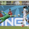 United States\' goalkeeper Tim Howard can not stop a shot by Germany\'s Thomas Mueller to score his side\'s first goal during the group G World Cup soccer match between the United States and Germany at the Arena Pernambuco in Recife, Brazil, Thursday, June 26, 2014. (AP Photo/Julio Cortez)
