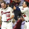 Photo -   Atlanta Braves' Chipper Jones (10) celebrates his three-run, walk-off home run with Martin Prado (14) after a baseball game against the Philadelphia Phillies, Sunday, Sept. 2, 2012, in Atlanta. The Braves won 8-7. (AP Photo/Daniel Shirey)
