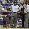 Photo - ADVANCE FOR WEEKEND EDITIONS, AUG. 30-31 - In this May 2, 2014, file photo, umpires CB Bucknor, left, and Dale Scott, right, listen during a replay review in the first inning of a baseball game, Friday, May 2, 2014, in Miami.  There were more than 1,000 challenges so far in this new era of replay, and it's only August. Now get ready for an even longer postseason parade of those slow strolls, when a ruling could really be the difference between a World Series winner and an early exit. (AP Photo/Lynne Sladky, File)