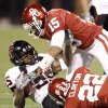 OU\'s Dominique Franks, top, and Keenan Clayton bring down Emmanuel Jones of Texas Tech during the college football game between the University of Oklahoma Sooners and Texas Tech University at Gaylord Family -- Oklahoma Memorial Stadium in Norman, Okla., Saturday, Nov. 22, 2008. BY BRYAN TERRY, THE OKLAHOMAN