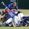 Binger-Oney players celebrate their win during the Class A fall baseball state championship game against Silo at the Chickasaw Bricktown Ballpark. Photo by Sarah Phipps, The Oklahoman