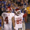 Oklahoma\'s Kenny Stills (4) stands with Ryan Broyles (85) after his touchdown reception that set a new NCAA reception record during the college football game between the University of Oklahoma Sooners (OU) and the University of Kansas Jayhawks (KU) on Sunday, Oct. 16, 2011. in Lawrence, Kan. Photo by Chris Landsberger, The Oklahoman