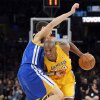 Los Angeles Lakers guard Kobe Bryant, right, drives past Golden State Warriors guard Klay Thompson during the first half of their NBA basketball game, Friday, Nov. 9, 2012, in Los Angeles. (AP Photo/Mark J. Terrill)