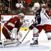 Columbus Blue Jackets\' Brandon Dubinsky (17) tries to control the puck to get a shot on goal as Phoenix Coyotes\' Jason LaBarbera (1) moves in to make a save during the second period in an NHL hockey game, Wednesday, Jan. 23, 2013, in Glendale, Ariz. (AP Photo/Ross D. Franklin)