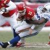 Photo - Kansas City Chiefs quarterback Alex Smith (11) is sacked by Indianapolis Colts defensive end Cory Redding (90) during the second half of an NFL football game at Arrowhead Stadium in Kansas City, Mo., Sunday, Dec. 22, 2013. (AP Photo/Ed Zurga)