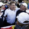 Europe\'s Luke Donald, Ian Poulter, Lee Westwood and Rory McIlroy celebrate after winning the Ryder Cup PGA golf tournament Sunday, Sept. 30, 2012, at the Medinah Country Club in Medinah, Ill. (AP Photo/David J. Phillip) ORG XMIT: PGA224
