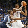 Oklahoma City\'s Kevin Durant (35) keeps the ball away from Sam Young (4) of Memphis in the first half during game one of the Western Conference semifinals between the Memphis Grizzlies and the Oklahoma City Thunder in the NBA basketball playoffs at Oklahoma City Arena in Oklahoma City, Sunday, May 1, 2011. Photo by Nate Billings, The Oklahoman