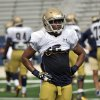 Photo - In this photo taken on Aug. 19, 2014, Notre Dame linebacker Cody Riggs watches a drill during NCAA college football pracice in South Bend, Ind. (AP Photo/Joe Raymond, File)