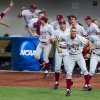 Photo - Players from the Standford bench erupt in cheers as Stanford University's Wayne Taylor (7) rounds the bases after hitting a three-run homer during an NCAA college baseball regional tournament game in Bloomington, Ind., Sunday, June 1, 2014. Stanford defeated Indiana 10-7. (AP Photo/Doug McSchooler)