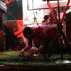 Antonio Laster of Brother Bear fixing his gear during his Wednesday Buffalo Lounge set at SXSW.