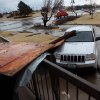 Pieces of a shopping center lie on a car near Northwest Expressway and Rockwell following storms in Oklahoma City on Tuesday, Feb. 10, 2009. By John Clanton, The Oklahoman