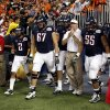 Arizona head coach Mike Stoops runs on the field during the Valero Alamo Bowl college football game between the Oklahoma State University Cowboys (OSU) and the University of Arizona Wildcats at the Alamodome in San Antonio, Texas, Wednesday, December 29, 2010. Photo by Sarah Phipps, The Oklahoman