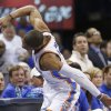 Oklahoma City Thunder guard Russell Westbrook (0) smashes his hand onto the scorer\'s table after colliding with Houston Rockets guard Patrick Beverly Beverley in the second quarter of Game 2 of their first-round NBA basketball playoff series in Oklahoma City, Wednesday, April 24, 2013. (AP Photo/Sue Ogrocki)