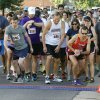 Photo - Runners begin the 5K part of the Fine Arts Institute of Edmond's annual 5K to Monet event in downtown. PHOTO BY PAUL HELLSTON, THE OKLAHOMAN.    PAUL HELLSTERN - Oklahoman