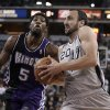 San Antonio Spurs guard Manu Ginobili, right, drives against Sacramento Kings forward John Salmons during the first quarter of an NBA basketball game in Sacramento, Calif., Tuesday, Feb. 19, 2013. (AP Photo/Rich Pedroncelli)