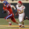 OCS\' Connor Sikes rushes up field as Davis\' Chase Taliaferro chases him during the Class 2A high school football championships between Davis and Oklahoma Christian School at Boone Pickens Stadium in Stillwater, Okla., Saturday,Dec. 8, 2012. Photo by Sarah Phipps, The Oklahoman